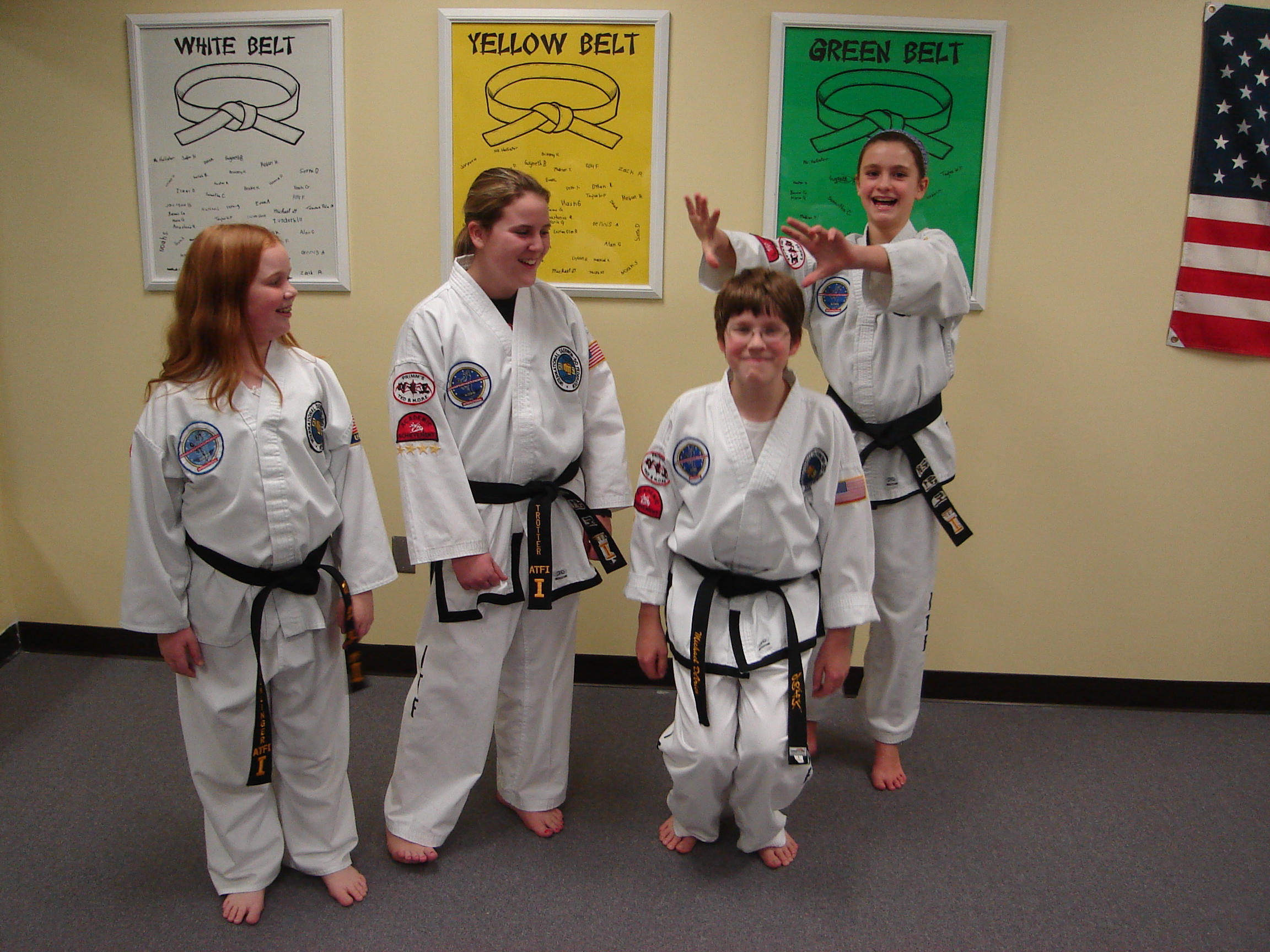Youth 1st degree black belts having fun being silly